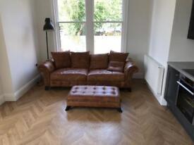 Beautiful Italian leather 4 seat sofa and foot stool