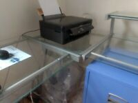 Multi level glass and metal table suitable for office work