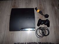 black PS3 with controller and games
