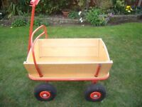Childs outdoor wooden cart. Very well made and of solid construction.
