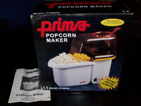 Boxed Prima Popcorn Maker uses hot air not oil to produce healthy snack