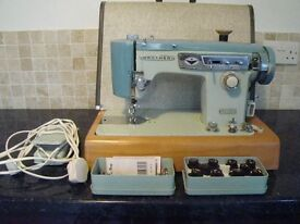 Vintage Brother sewing machine, spare feet, bobbins & box of cams.