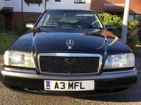 Beautiful Mercedes C Class Automatic. Ebony coachwork complimented by Ivory upholstery & Walnut trim