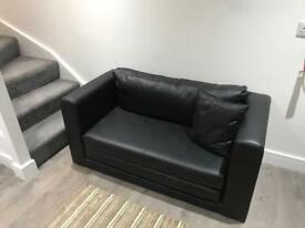 Near new sofa bed, 2 seater, Black