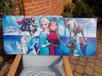 A FROZEN PICTURE ON CANVAS 48 inches LONG BY 20 inches WIDE IN GOOD CONDITION
