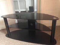 Corner TV Stand. black glass top and shelf