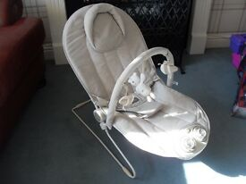 Mamas and papas baby bouncer with rhyme and vibrations very clean and hardly used