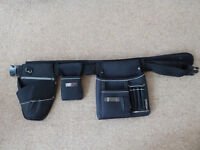 Tool belt with holster and pouch.
