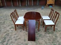 Extendable table with 4 chairs, used condition