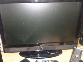 "26"" Technika television , wall mount with shelf and Samsung DVD player"