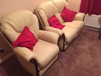 2 seater leather sofa and 2 arm chairs with wood effect. Never used! Like new condition