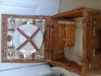 A 40cm square picnic hamper for two persons with wine cooler, glasses, plates and cutlery