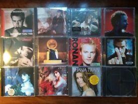 12 Assorted CDs