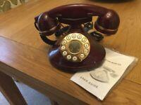 OLD FASHIONED BURGUNDY COLOURED TELEPHONE