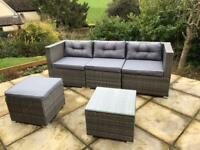 Rattan garden furniture set - sofa, table, stool, rain cover