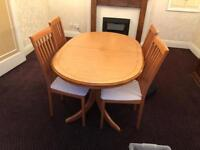 Wooden extendable wooden table and 4 chairs