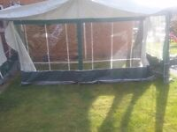 Dorema caravan awning size 11 in green and grey. Hardly used. No rips or tears. Includes extras.