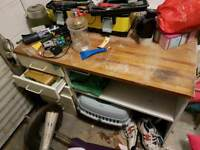 Kitchen unit used as garage work bench