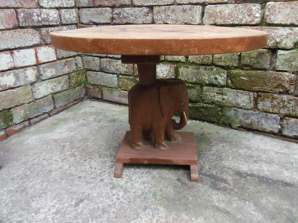 Elephant carved coffee table L 60cm W 46cm H 45cmin Penny Lane, Merseyside - Vintage table, structurally solid and dry stored for many years. In need of cosmetic tlc Top and surround are smooth but superficially marked. No rot, weakness or loose joints and no damage to carved elephant. Viewing welcome. 07804694781
