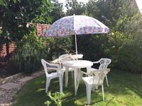 White plastic table and chairs