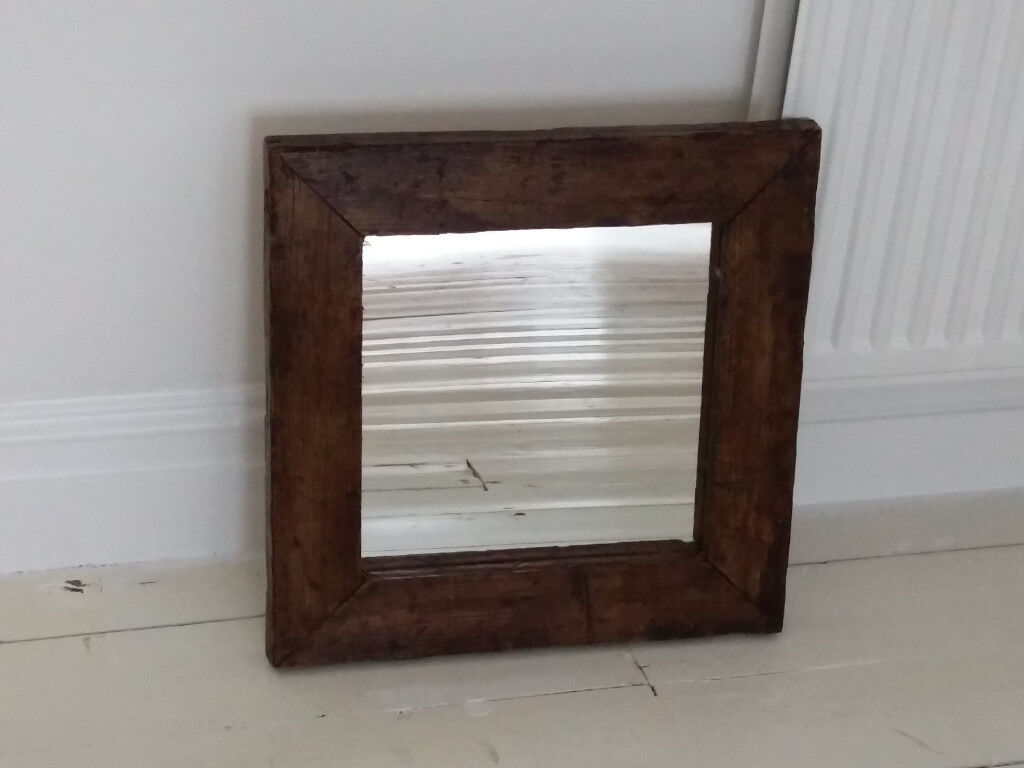 Mirror set in reclaimed chunky wooden frame