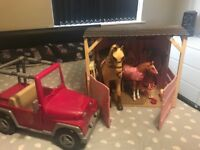 Our generation stable horse foal and jeep