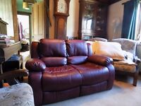 small two seater leather sofa hardly used.