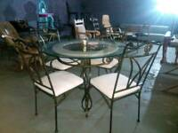 Stunning round glass and wrought iron dining table with marble centre & 4 chairs