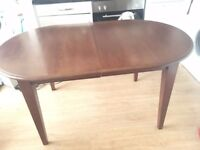 Beautiful walnut extendable table to 6 and 4 matching antique chairs