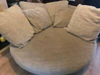 Swivel arm chair brown and creamy colour from SCS