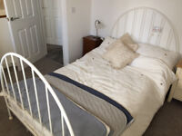 Small double bed (4' wide), white metal in excellent condition