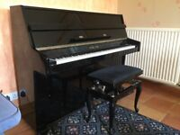 Piano and stool Beautiful tone and elegant upright piano in gloss black. Buyer collects.