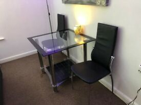 Black/clear glass table and 2 chairs