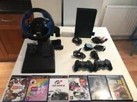 PlayStation with Logitech driving wheel and camera