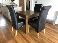 Oak style extendable table and 4 leather style chairs