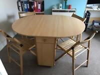 Foldable table with 4 chairs.