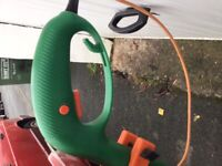Used Electric strimmer works perfect new strimmer line in it