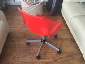 Red computor chair with casters