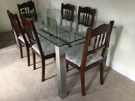 Glass topped dining table, matching coffee table and side tables available