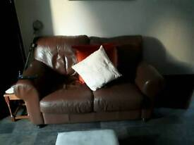 2x2 seater couches in tan colour.