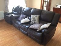 Brown faux leather sofa, each end is a recliner