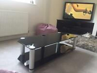 Designer black glass and brushed chrome TV stand