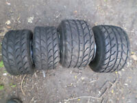 4 wet gokart wheels and tyres 2 front wheels and tyres and 2 rear wheels and tyres