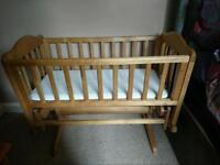 Swinging crib with mattress