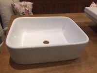 White ceramic counter top sink