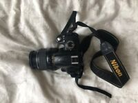 Nikon D3000 camera with lens and battery/charger
