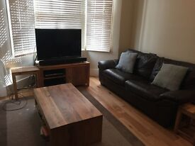 Two brown leather DFS Sofas in good condition