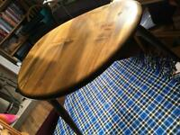 Dark wood Ercol Pebble tables two