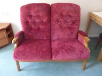 Sofa - Bugandy material with teak arms and legs - two seater