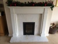 Marble fireplace and wooden surround. Fire not included.